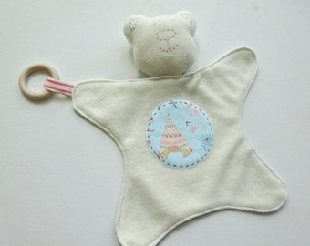 Teepee tent pastel blue background. baby teddy bear comforter with wooden ring and rattle. baby comforter. toy comforter.