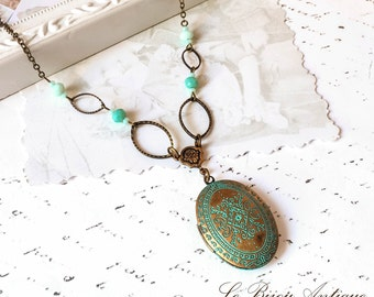 Antique Locket necklace with Blue Crustals and moroccan blue carvings Antique bronze handcrafted chain Two pictures family gift for her