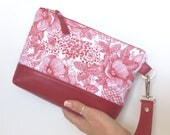 Issie Clutch:  Red sketched floral with a Red leather base and full black leather back