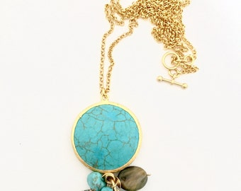 Turquoise set in 22K Gold plated bezel with assorted Crystal charms