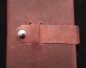 Refillable Leather Journal Cover with strap closure.