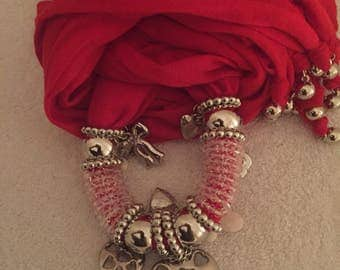 Red scarf with 30 hand selected charms, fringed tips used to show creativity. Available in pink as well
