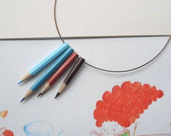 Brown wooden necklace with colored pencils and Heavenly