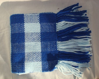 6ft, Handwoven Baby Blue/Royal scarf, approximately 6ft long 6.5in wide with 3-4in trim. Machine washable and dryer safe.