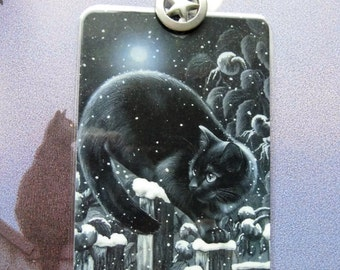Bookmark  Black cat on a fence