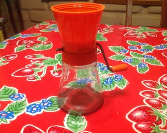 Vintage orange plastic, metal, and glass  Androck nut grinder