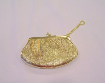 Gold wristlet/coin purse by Budd Leather Creation