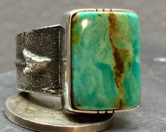 Tufa cast sterling silver ring with high grade pilot mountain turquoise!
