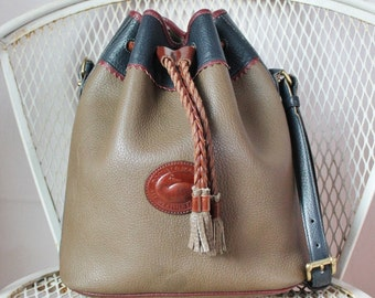 Vintage Dooney And Bourke All Weather Leather Brown Blue Red Large Teton Drawstring Hobo Shoulder Bag With Padded Strap Made In USA
