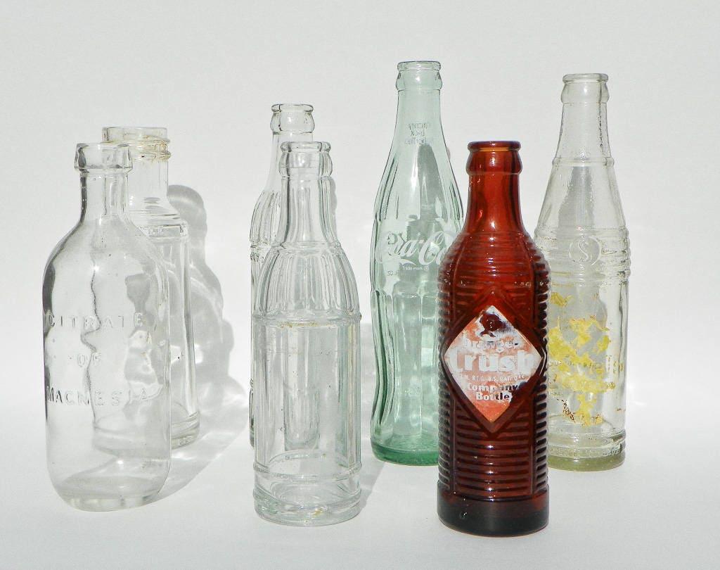 Seven vintage glass bottles clear brown soda pop bottles for Retro glass bottles