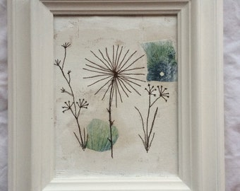 Mixed media free machines seed heads in painted white wooden frame