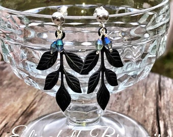Black leaf post earrings with blue iridescent drops.