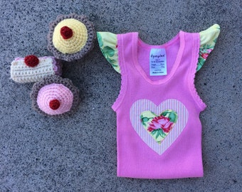 Pretty baby top, baby singlet , tank top, size 6-12 months.pretty flutter sleeves .