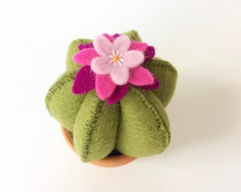 green wool felt cactus pincushion with a pink flower