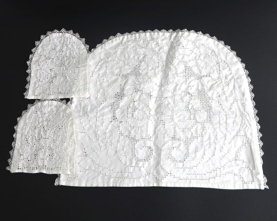 White embroidered teapot cozy and 2 matching egg cup covers, cotton with lots of open cut work, tatted edging, handmade, circa 1920s