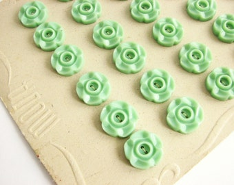 Small green buttons on a vintage button card, antique mint green buttons in flower shape, 1930s flower buttons, 14mm