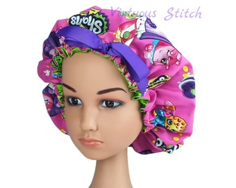 Child Bonnet made with Shopkins Printed Cotton Fabric with  Apple Green Satin Lining Adjustable