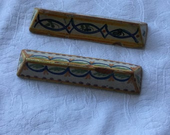 Two French Quimper stoneware knife rests