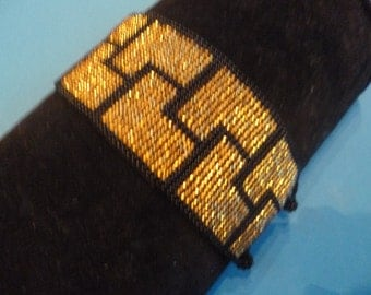 Gold and black hand beaded bracelet: Made in Guatemala