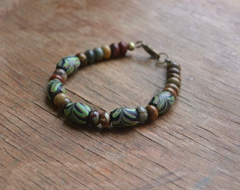 Trade bead bracelet with antique Venetian feather beads and jasper