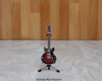 Handmade miniature guitar pendant