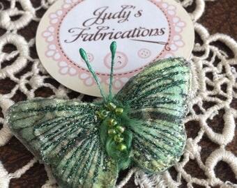 Green iridescent butterfly brooch