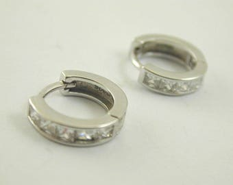 Silver hinged hoop earrings with square set cubc zirconia pretty