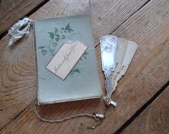 A vintage carnet de bal and a fragment of a fan shaped carnet de bal