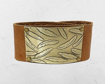 """Feathers Leather Cuff Bracelet- one of a kind , falling feather on 1.25"""" wide leather cuff."""
