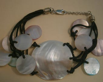 D143) A lovely pink green white mop shell and knotted cord bracelet with 925 silver clasp