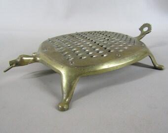 Vintage brass turtle shaped grater