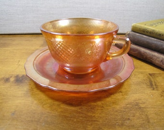 Federal Glass - Normandie - Iridescent Orange Glass Teacup and Saucer Set