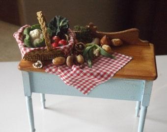beautiful handmade miniature kitchen table with a handmade basket of veg, 1/12 scale dollhouse miniature