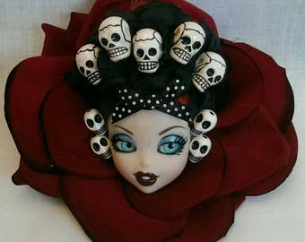 Day of the dead skulls doll head in red rose fascinator