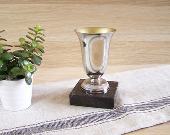 """Silver cup non engraved pedestal gray marble 