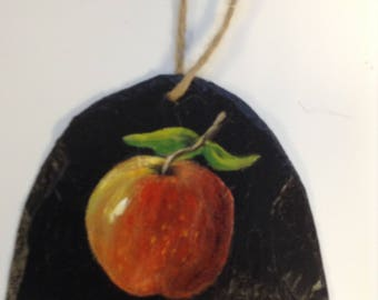 "An apple painting on black slate with acrylic. Price 12.00 Size: 51/2"" x61/2"""