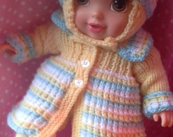 Lovingly knitted 3 piece pram suit in pastel shades of lemon, blue and white fits 30cm/12 inch baby doll