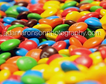 Photograph of a sea of M&M's.