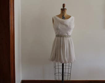 1960s White petite party dress with beaded belt.