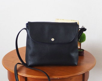 Small black leather crossbody bag with flap