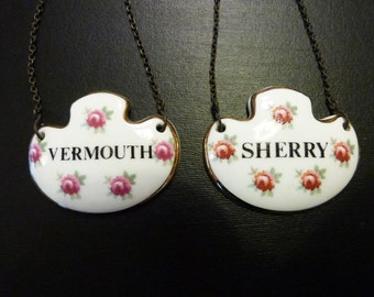 A pair of Royal Adderley English porcelain decanter labels.
