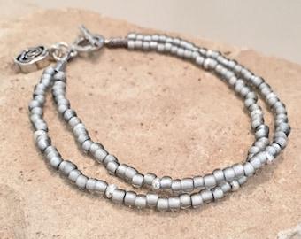 Gray double strand seed bead bracelet, Hill Tribe silver bracelet, flower charm, charm bracelet, boho bracelet, sundance style bracelet