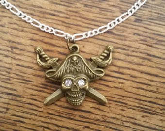 Antique style pirate / skull and crossbones pendant necklace - diamante eyes - white figaro chain