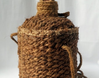 Old bottle in glass covered with braided string / thong / antique bottle / french folk art / woven rope / crafts