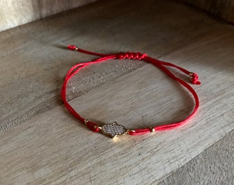 Fatma hand bracelet with red string