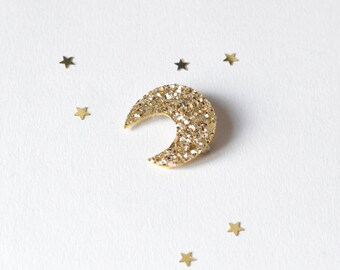 Brooch in the shape of moon in gold sequins