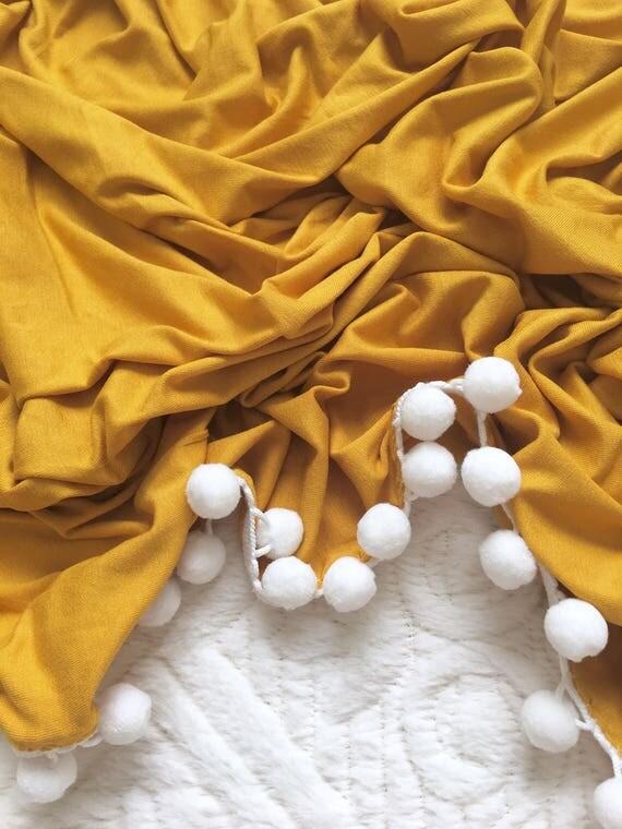 Mustard Pom Swaddle Blanket
