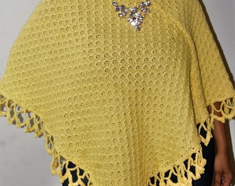 100% Cotton Knitted/Crocheted trimmed poncho. Wonderful for cool and breezy days and evenings.