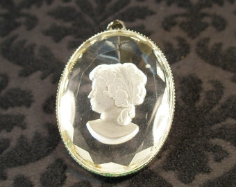 Reverse etched clear cameo pendant
