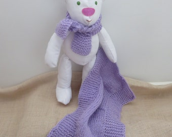 Marija. The cute, cuddly, white material, soft, handmade Teddy Bear with a purple wool scarf and blanket.